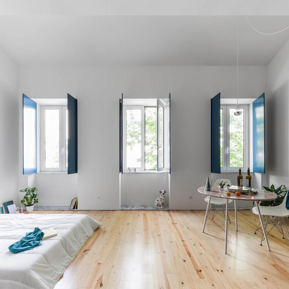 Fala Atelier designs Apartment in Porto Features Deep Blue Shutters