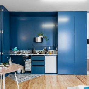Fala Atelier designs Apartment in Porto Features Deep Blue Shutters