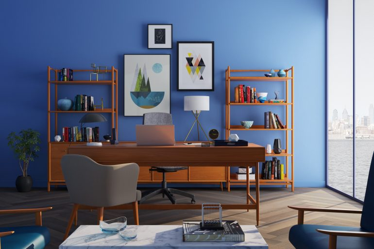 bold prints and colour How to Embrace Bold Prints and Colour in Your Home bookcase chairs clean 667838 770x513